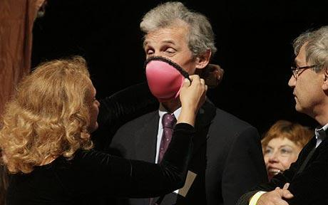 Wolfgang Ketterle is fitted with a bra that turns into gas mask